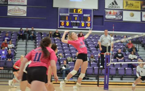 Junior Megan Flom moves to spike against Minot State University on Saturday, Oct. 26 in the McCown Gymnasium.