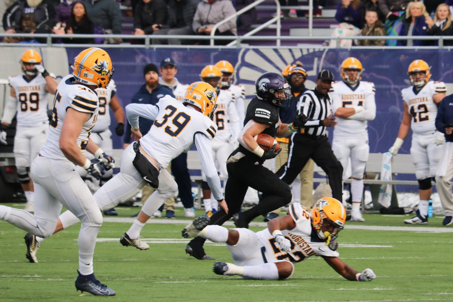 Winona State junior wide receiver Jake Balliu dodges Augustana players as he advances the football down the field at the Winona State vs. Augustana game on Saturday, Nov 9. Despite their efforts, the Warriors fell 25-26 to Augustana.