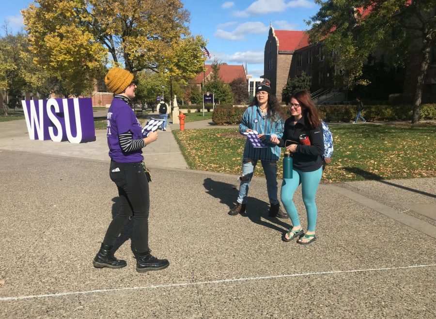 Junior Krissy Smith-Szymaniak and senior Alejandra Torres handed out buttons and stickers for NARAL Pro-Choice Minnesota on Thursday, Oct. 24 as a counter protest to pro-life messages that had been chalked around campus the previous night.