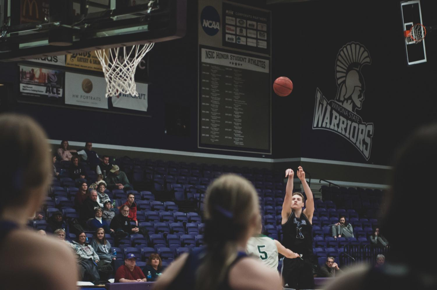 Winona State sophomore, Luke Martens looks to shoot a three-pointer in the second half of the game against Bemidji State. The warriors secured their win, scoring 82-74 on Saturday, Jan. 18 in McCown Gymnasium.