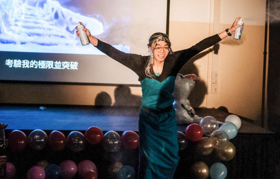 "Yukuang Chu sprays two cans of mist to imitate Elsa's ""Let It Go"" performance in Frozen. The Chinese Dinner on Friday, February 7 at Kryzsko Commons celebrated Chinese culture, served cultural foods and prepared multiple games for students to win prizes."