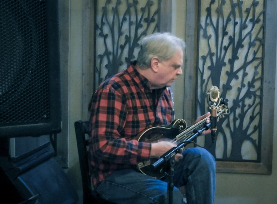 "Local musician Jim Reineke performed ""Blues and Bluegrass"" music on his mandolin inside Blooming Grounds Coffee Shop on Wednesday, Feb 19. Jim Reineke, currently a member of the Wing Dam Jammers and Turkey Creek in Winona began performing in Minneapolis in the early 1970s as a solo performer."