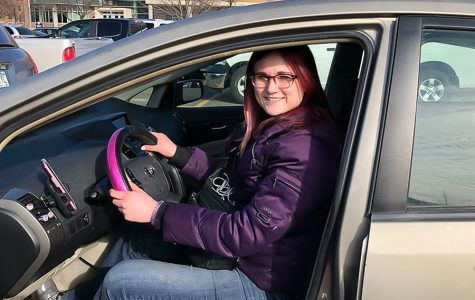 Lex Lea, a Winona State junior, poses in the driver's seat of her Prius that has served as her vehicle of choice for the past six months as a Lyft driver. Winona didn't have Lyft until 2018, a direct driver-to-rider, cashless car service controlled solely by cell phones.