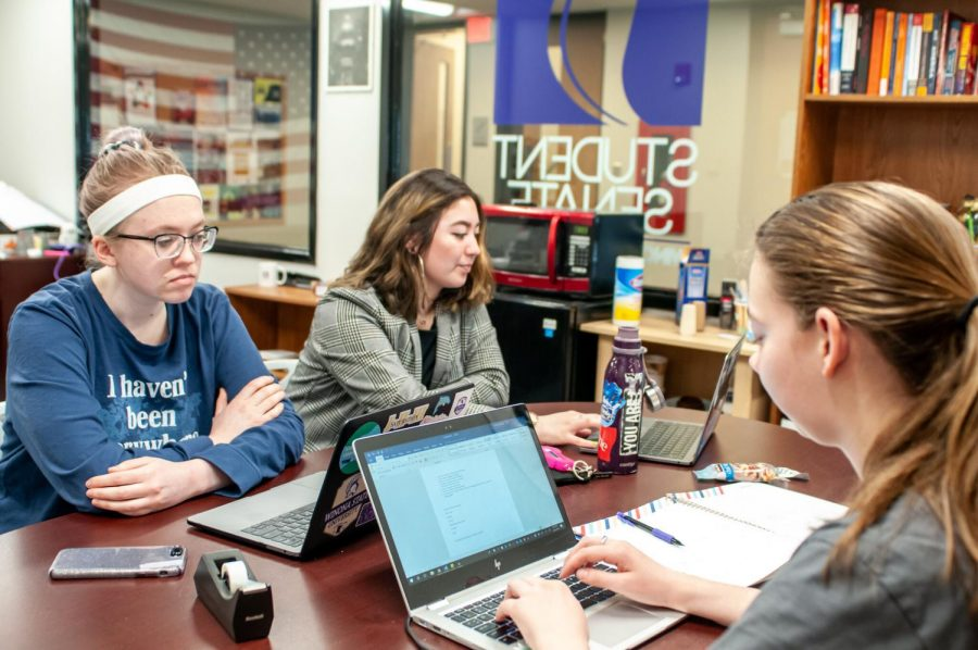 President of Sustainability Task Force Nicole Ruhland(right), a Biology and Spanish major senior, discusses plans for Earth Day 2020 with members of her task force, Abigail Oldenburg(left) and Madilyn Lavan(middle) at Student Senate office on Monday, Feb. 24. The goal of this task force is to help educate students on what can and cannot be recycled.