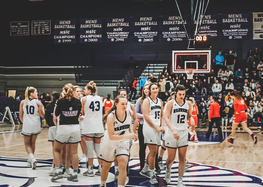 The women's basketball team huddles right before the ending of their game against Minnesota State University-Moorhead Dragons on Wednesday, Feb.26 in MacGown Gymnasium. The Warriors managed to hold off the comeback effort, winning 82-77.