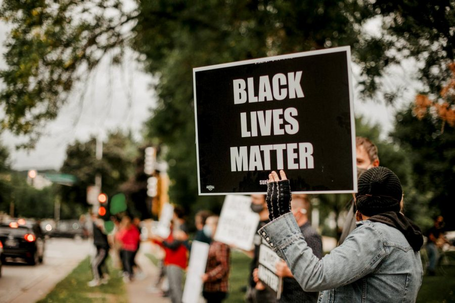 A+protestor+holding+a+Black+Lives+Matter+%28BLM%29+sign+at+Windom+Park%2C+on+Tuesday%2C+Sept.+1.++A+group+of+people+took+part+in+a+peaceful+protest+led+by+Eileen+Hanson.+The+protest+Black+Lives+Matter+supports+people+of+color+fighting+police+brutality.+Specific+names+in+context+come+up+including+George+Floyd%2C+Breonna+Taylor%2C+and+many+more.+The+motorists+passing+by+expressed+support+by+honking.