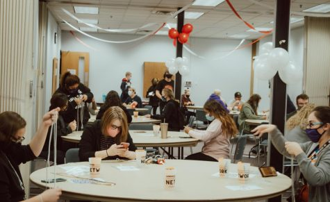 Masked students sit and create DIY keychains at Kryzsko Commons, on Friday, Oct. 2. Students must now adapt to mask ordinances and social distancing guidelines while engaging in on-campus activities.