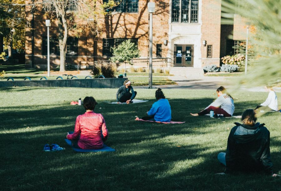 Josephine Osowski, lead fitness instructor for Winona State, led the first of two sessions of Sunset Yoga by Phelps Lawn, on Monday, Oct. 12. The event is a part of the WSU Spirit Week held from Oct. 12-16.