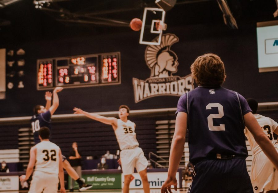 Winona State junior, Owen king attempts a shot for a 3-pointer against Wayne State, at the second game of the weekend on Saturday, Jan. 30. Warriors lost 84-78 against Wayne State