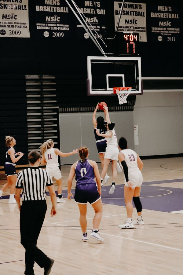 """Winona State University Warriors' women's basketball team went up against the Mankato State Mavericks this past weekend in back-to-back home games. Going into the games the Warriors knew what to expect from their opponent having played them in the past. Second-year guard Caitlin Riley said the key to beating Mankato is not turning the ball over. """"Mankato is very good at frustrating teams and making them turn the ball over, and when they don't turn teams over, they struggle to score in the half court,"""" Riley said. """"On offense we had to focus on passing to break down their defense instead of dribbling."""" In Friday's game, fourth-year forward Taylor Hustad got a double-double with a team-high 18 points and 10 rebounds. Unfortunately, the Warriors came up a short in the game, ending with 59 points while the Mavericks secured 79 points.  The loss made the Warriors' losing streak against Mankato go up to four losses. Winona State also played against Mankato State the following day. The game started off slow for the Warriors, but despite their loss the night before, the team showed up ready to play and was able to secure the win. Saturday's game was huge for senior guard, Allie Pickrain as she earned her 1,000 career point while playing for the Warriors. Pickrain scored 20 points in the game, including the final points of the game in overtime. Riley said due to COVID-19 and COVID restrictions, fans aren't allowed in the stands at the games, making the atmosphere totally different for the players """"I think the lack of fans is a big difference for all of us athletes,"""" Riley said. """"A loud bench is very important as it provides a lot of energy for the team."""" Riley said the team is looking forward to having games go back to normal, pending restrictions being lifted in the future.  """"We are all excited for fans to cheer us on in person soon,"""" Riley said. Fourth-year center, Emma Fee, led the team in points on Saturday. Fee ended the game just 22 points shy of her season high of 30 """