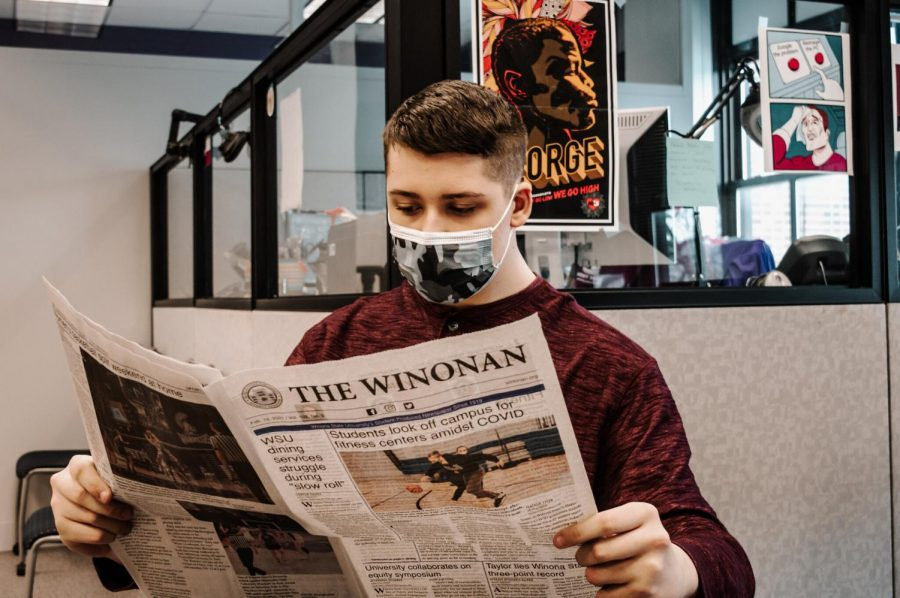 Gavin Jacob, a freshman majoring on Computer Science, following the articles published by the Winonan. Three new reporters joined the Winonan this semester, none majoring in journalism.