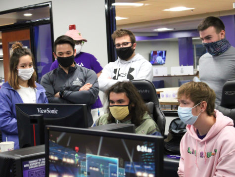 Students participating in the Super Smash Bros. tournament held in the Warrior Esports Lounge from 7-10 p.m. on March 25. From left to right: Samantha Soroos, Jarred Schmitz, Luke Torian and two more students.