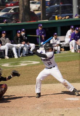 Photo of Winona State University's Sam Kohnle at plate against Minnesota-Crookston, from Winona State University's officialathletics website. Image taken in Loughrey Field at Winona State University.