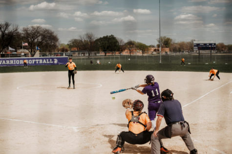 Photo of fifth-year catcher Alison Nowak swinging for the Winona State women's softball team during the games against University of Minnesota-Crookston.
