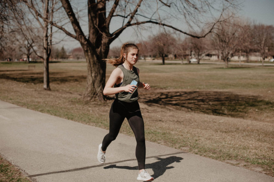 Fourth-year student at Winona State, Savannah Rachel, runs around Lake Winona Saturday mornings. Rachel said she stays active when she can by running outside or working out in the IWC when it is not as busy.