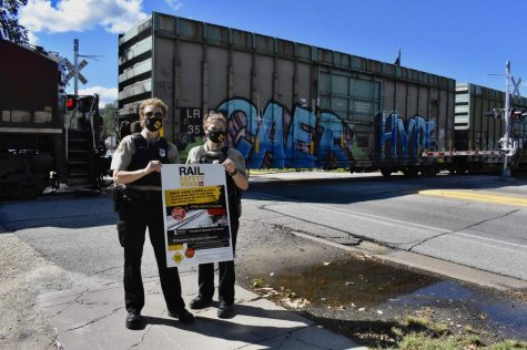 Canadian Pacific Railway (CPR) Special Officer Tracy Bergerson (left) and CPR Special Officer Michele Mair (right) at the Huff St. railroad crossing at 12:15 p.m. on Sept. 22, 2021 in celebration of Rail Safety Week 2021. Both Bergerson and Mair have worked with Rail Safety Week for years, Winona being one of their favorite stops, they said. It is Winona State University's fifth year participating in the event.