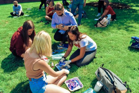 Students tie-dying outside of Winona State's courtyard.