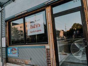 Recently a sign has been placed on the front door of ZaZas Pub and Pizzeria across from Winona State Universitys campus. John Sinniger, director of dining services at the university, along with his wife Carolyn Sinniger, now own the new ZaZas.