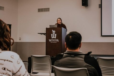 Jouapag Lee, the guest speaker of Oct. 13s Expanding Perspectives series second event, pictured presenting in the Kryzsko Ballroom. Lee spoke about the encounter at Winona State that sparked her involvement in social justice, among other topics.